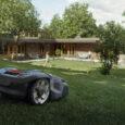 robot koszący kosi trawę przed domem